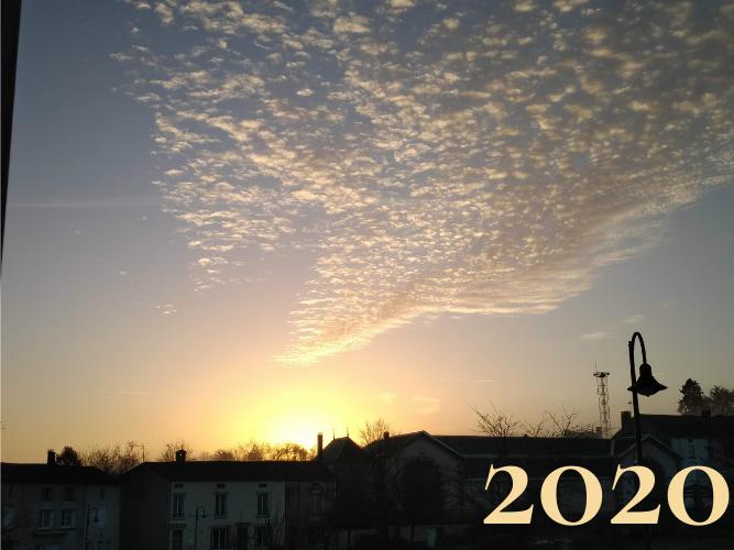 Sunrise over village with 2020 in corner