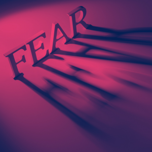 The word FEAR is in capital letters with their shadow. The whole is in fuschia and orange colours.