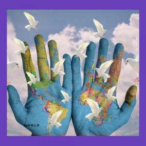 Two hands painted with the world map. Background of blue sky with fluffy white clouds. Foreground of doves.
